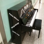 "A piano in Heathrow Terminal 3. The Finnish ""Pelaa minua"" must have been translated using Google..."