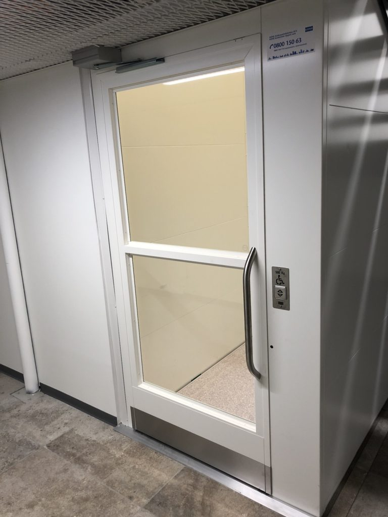 Door to small wheelchair lift